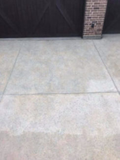 Driveway with freshly pressure washed surface