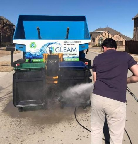 A Pressure Washing Tech Cleans a Driveway