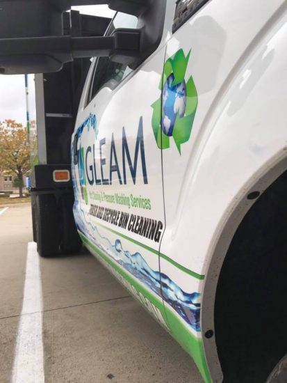 A GLEAM Branded Truck from the side