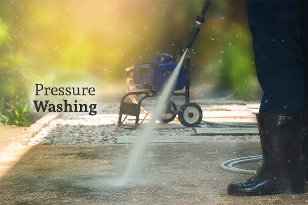 "A person pressure washing concrete beside the words ""Pressure Washing"""