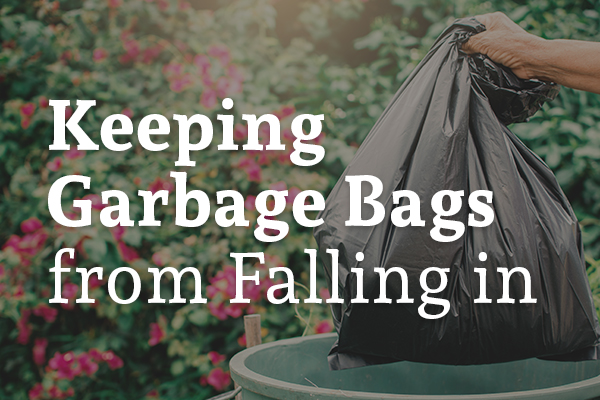 A person lifting a garbage bag out of an outdoor trashcan with the words, keeping garbage bags from falling in.